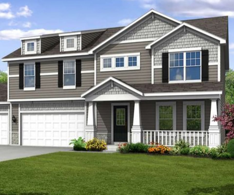 A house with two car garage, sided with stormy gray siding. The porch has white rail, the yard is beautiful with landscaped orange and yellow flower beds. To get your own vinyl siding cost estimate, call 815-235-7766 or fill out our free estimate form below.
